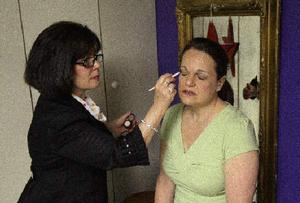 JAMIE GERMANO - Staff Photographer - Democrat & Chronicle Cindy Kyle, applying makeup to client Paula Vullo, says a tough economy has increased her business with individuals.