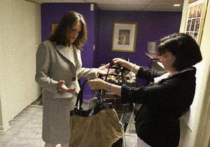 JAMIE GERMANO - Staff Photographer - Democrat & Chronicle Image consultant Cindy Kyle, right, helps match a purse with a suit for client Paula Vullo. Image consultants also offer such services as interview counseling and communication skills.